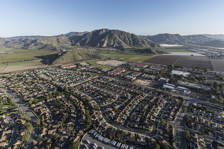 Camarillo, CA - Aerial View of Community in California at Dusk with Mountains in the Distance