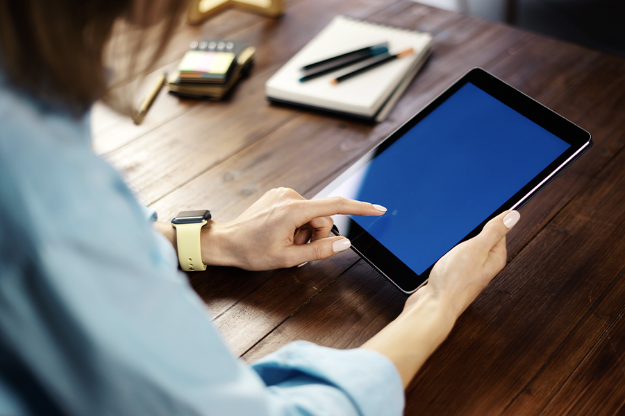 Client Center - Closeup of a Woman Using a Tablet to Access Her Account Information From Insurance Incorporated Agency
