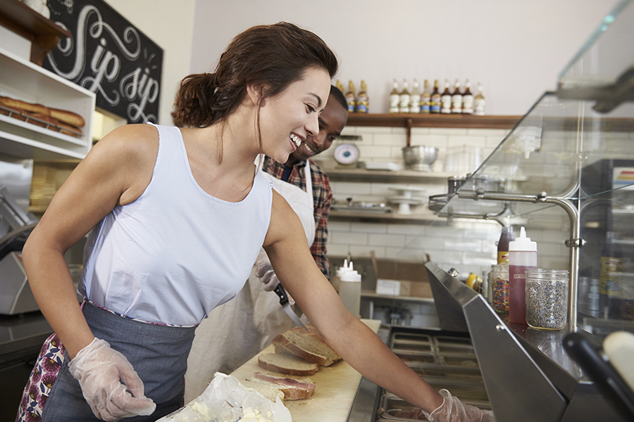 Sandwich Shop and Deli Insurance - Girl Working in a Deli and Making a Sandwhich