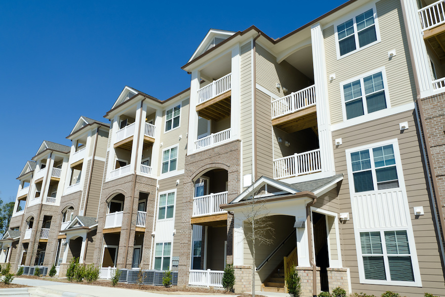 Apartment-Building-Insurance-New apartment building in suburban area